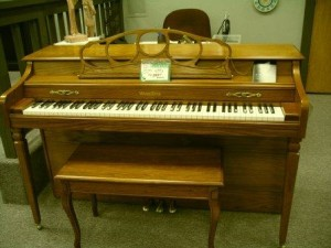 Spinet pianos are compact, and therefore have a drop action. This is generally less desirable than a console or grand.